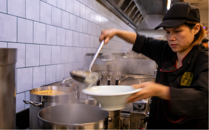 chef cooking with stock pot cooker